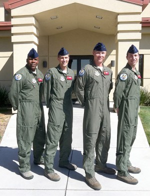 Left to right, Senior Master Sgt. Alton Prayer, Capt. Timothy Ober, Capt. Jonathan Hansen (aircraft commander) and Lt. Andrew Wuebold are four of the six Travis Air Force Base aircrew members who saved a two-year-old girl's life when she suffered a seizure while on their aircraft in flight. Not pictured are Staff Sgt. Michael Burk and Airman 1st Class Taylor Schuster Steiner. The aircrew are six of 20 Solano County residents being honored at an upcoming Heroes breakfast organized by the Solano County chalpter of the Red Cross. (Courtesy photo)