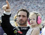Jimmie Johnson, left, points to the sky as his daughter Genevieve Marie Johnson watches before the NASCAR Sprint Cup Series auto race at Chicagoland Speedway in Joliet, Ill., Sunday, Sept. 16, 2012. (AP Photo/Nam Y. Huh)