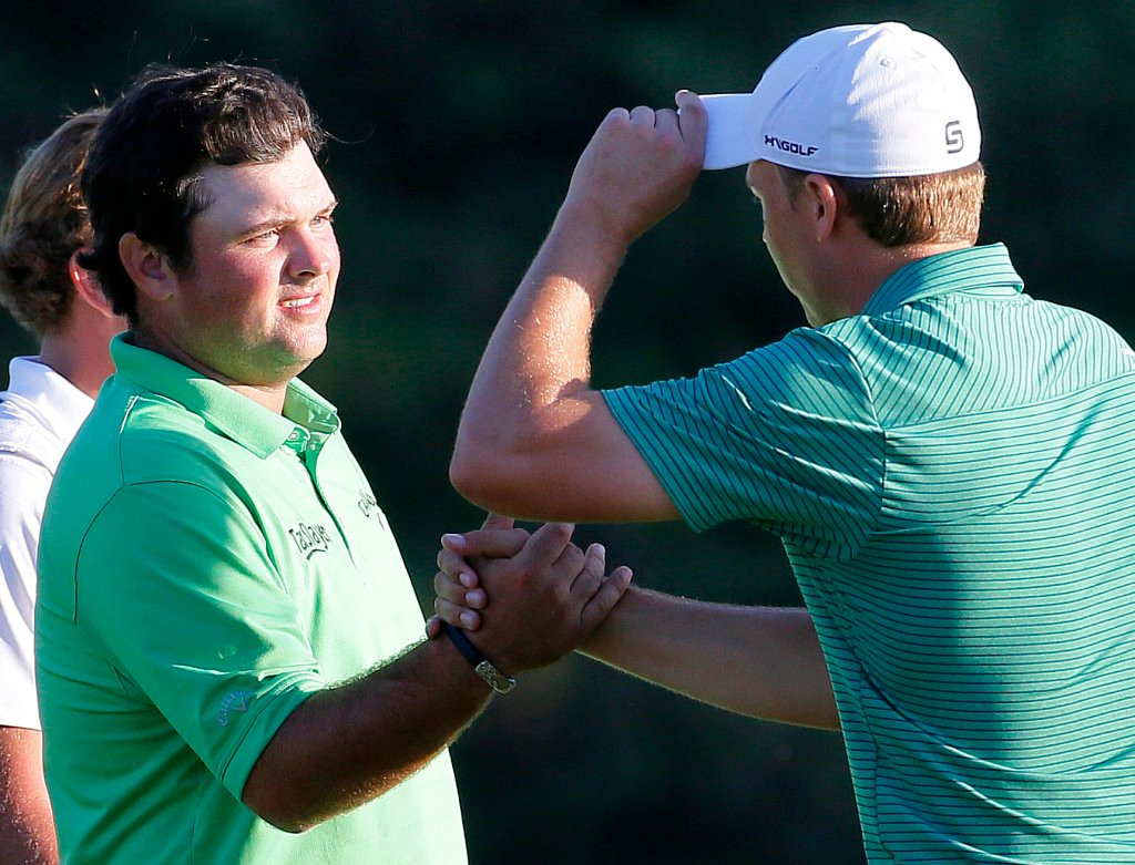 Patrick Reed, left, greets Jordan Spieth after the first round of the Tournament of Champions golf tournament Thursday, Jan. 7, 2016, at Kapalua Plantation Course on Kapalua, Hawaii. (AP Photo/Matt York)