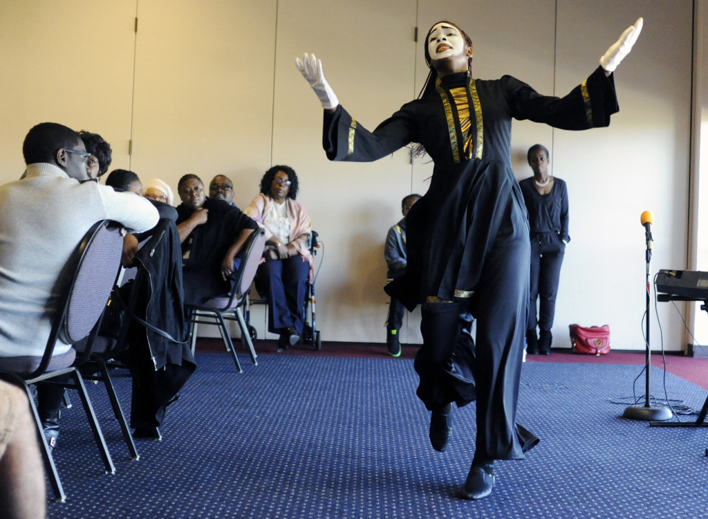Deajanae Duncan performs a praise dance during the Helping Children Around the World 2nd Annual Tea Program at Jelly Belly in Fairfield, Saturday. The benefit raised money to help children throughout the world. (Aaron Rosenblatt/Daily Republic)